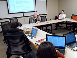 Donald Knebel shares many stories from his 39-year career with his students at Indiana University Maurer School of Law. He started teaching in 2011 at the invitation of his former colleague, Mark Janis (far right), director of the Center for Intellectual Property Research at IU Maurer. (IL Photo/ Marilyn Odendahl)